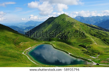 beautiful lake high in the alp mountains - stock photo