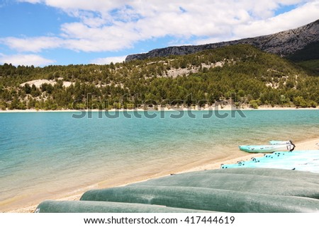 Beautiful Lake in Southern France with  Boats at the Shore - stock photo