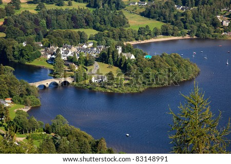 beautiful lake, loch, in scotland, united kingdom, europe, on a bright sunny day with deep blue water - stock photo