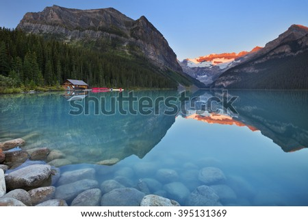 Beautiful Lake Louise in Banff National Park, Canada. Photographed at sunrise. - stock photo