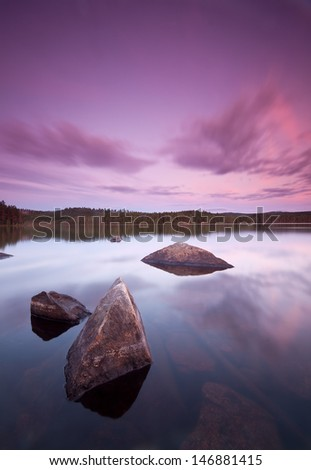 Beautiful lake sundawn with nice clouds and calm surface - stock photo