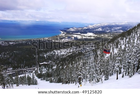 Beautiful Lake Tahoe in winter, with mountains covered with snow, California - stock photo