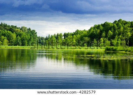 Beautiful lake view - bright interval between rain. Mazury, Poland. - stock photo