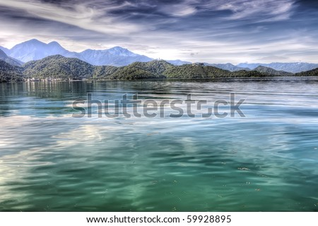 Beautiful lake with peace in green color, nature landscape in Taiwan. - stock photo