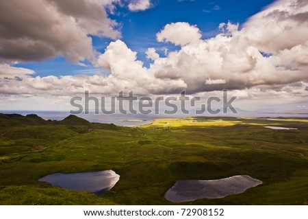 Beautiful lakes and sea with a dynamic cloudscape - stock photo