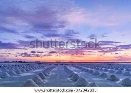 Beautiful landscape a salt farm in Thailand at sunset - stock photo