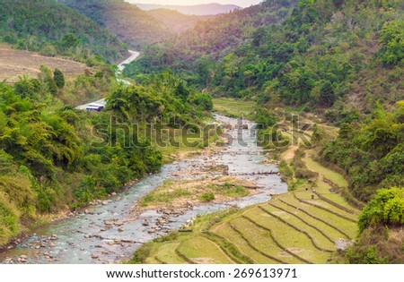 Beautiful landscape about terraced rice field with river in Myanmar. - stock photo