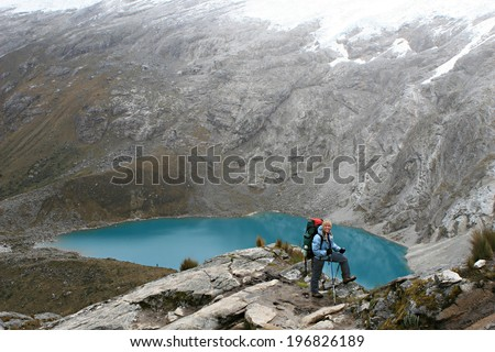 Beautiful Landscape along the scenic Santa Cruz Trek in Central Peru. The picture presents Taullicocha lake - stock photo