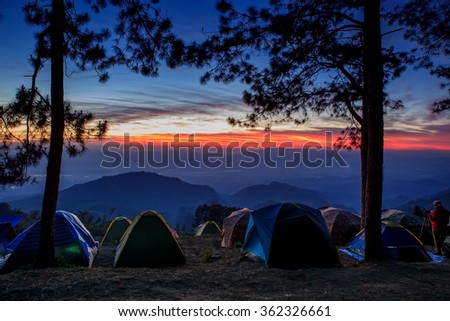 beautiful landscape and sun rising sky with traveling  camping tent field in angkhang -phahompok national park chiangmai northern of thailand - stock photo