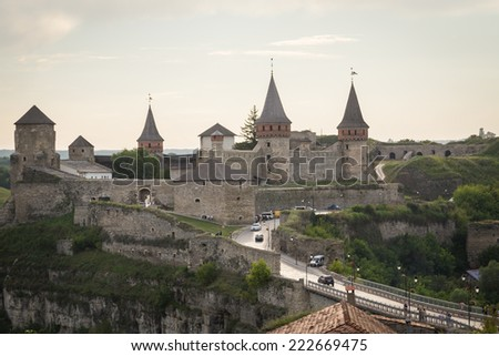 Beautiful landscape at sunset. View of the medieval fortress in the evening. Castle, travel, evening, historic sites, the bridge - travel to the historical monuments. Background to postcards. - stock photo