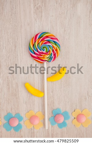 Beautiful landscape formed with a lollipop and candies resembling a flower