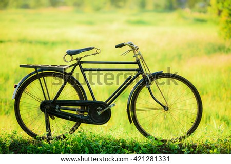 beautiful landscape image with vintage bicycle