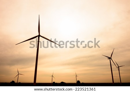 beautiful landscape image with Windturbine farm - stock photo
