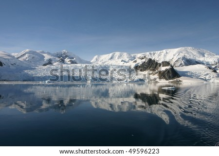 Beautiful landscape in Antarctica in morning light. Some snow covered mountains. - stock photo