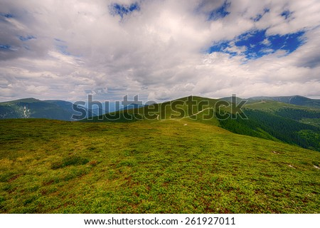 Beautiful landscape in the mountains with blue sky - stock photo