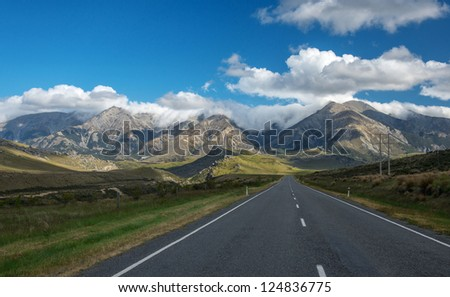 Beautiful landscape mountains and lake, Lupines fields, south island, New Zealand - stock photo