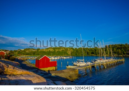 Beautiful landscape of a dock in the west coast of Sweden during the summer - stock photo