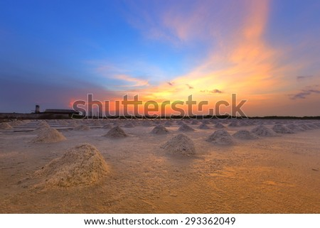 Beautiful landscape of a summer with a salt farm in Thailand at sunset - stock photo