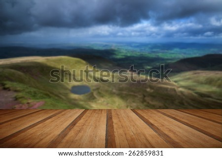 Beautiful landscape of Brecon Beacons National Park with dramatic sky with wooden planks floor - stock photo