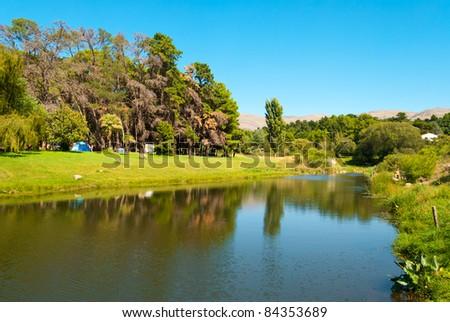 Beautiful landscape of campingsite with green forest near a stream  in Villa Ventana, Sierra de la Ventana, Argentina - stock photo