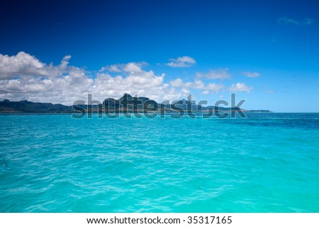 Beautiful landscape of eastern Mauritius from ocean - stock photo