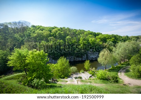 Beautiful landscape of forest, river and deep blue sky - stock photo