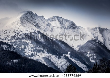 Beautiful landscape of high Alps covered by snow at morning - stock photo