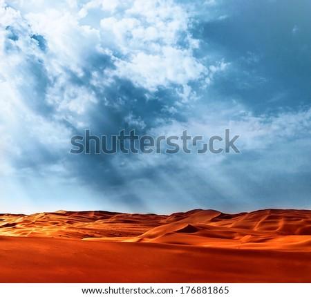 Beautiful landscape of Liwa desert, United Arab Emirates, Abu Dhabi, orange hot sand, blue cloudy sky, beauty of nature concept - stock photo