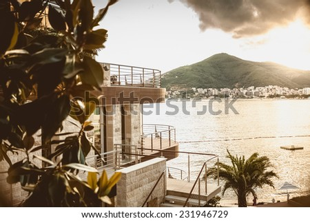 Beautiful landscape of luxury modern villa standing on top of mountain at sea shore - stock photo