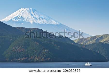 Beautiful landscape of Mount Fuji and Ashi-no-ko Lake from Motohakone, Japan, at evening haze, fall season - stock photo