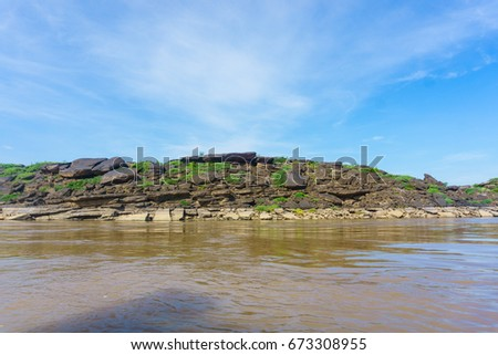 beautiful landscape of rock stone with green grass and beautiful blue sky background