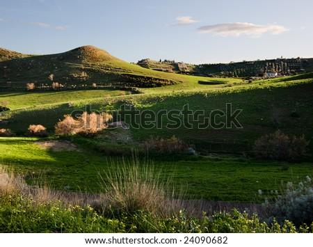 beautiful landscape of rolling grass - stock photo