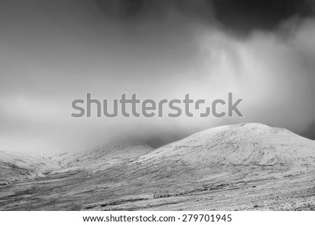 Beautiful landscape of snow covered mountain range in Winter in black and white - stock photo