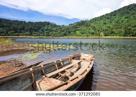 Beautiful landscape of the Laguna Verde with a boat, in Apaneca, Ruta de Las Flores itinerary, El Salvador - stock photo