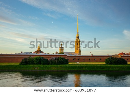 Beautiful landscape of the Peter and Paul Fortress with the lilac flowers at the front