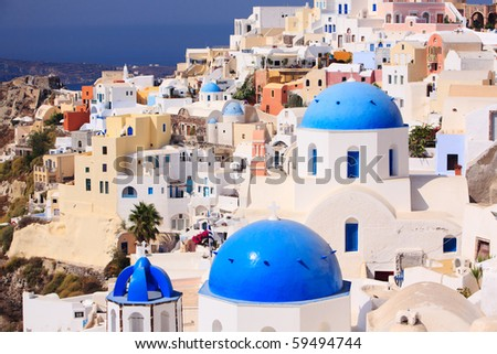 Beautiful landscape of traditional Greek little town Oia in Santorini - stock photo