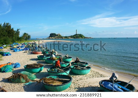 Beautiful landscape of Vietnam beach, group of boat on sand, people travel at seashore, Ke Ga cape faraway, blue sky, green tree make nice scene for Viet Nam travel - stock photo