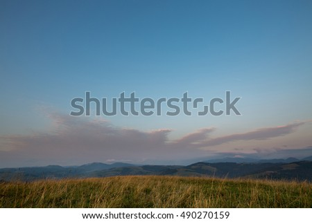Beautiful landscape on mountain with clouds in the sky