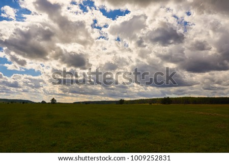 Beautiful landscape panorama. Nature composition. Bright colors under a blue sky with clouds.