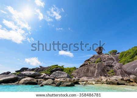 Beautiful landscape people on rock is a symbol of Similan Islands, sun on blue sky over the sea during summer at Mu Ko Similan National Park, Phang Nga province, Thailand