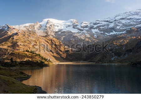 Beautiful landscape photo of mountains and lake on Trubsee / Titlis, in the Swiss Alps. - stock photo