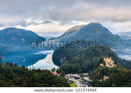 Beautiful Landscape Picture of Hohenschwangau in Autumn, Castle for the Kings of Bavaria near Munich, Germany. Picture was taken in foggy September - stock photo