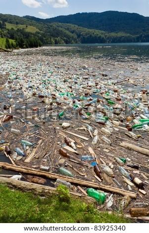 beautiful landscape ruined by  trash pollution, Bicaz lake, Romania - stock photo