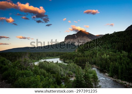 Beautiful landscape sunset mountain and river in Glacier National Park - stock photo