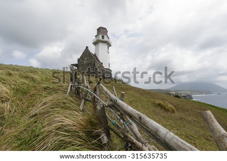 Beautiful landscape view of Sayid Lighthouse located at Batanes Island, Philipines. It has climate environment and   now very popular as a tourist attraction. - stock photo