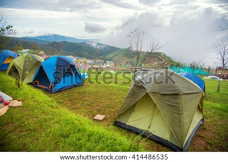 beautiful landscape view point of sea of clouds and tents on a hills at sunrise scene at phu tubberk , petchabun , thailand