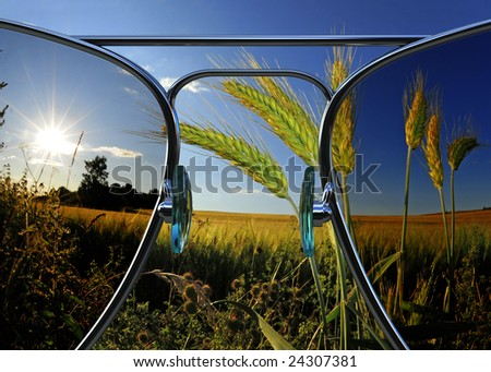 beautiful landscape view through 3d rendered sunglasses - stock photo
