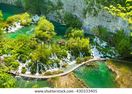 Beautiful landscape, waterfall, and wooden pathway in Plitvice Lakes National Park in Croatia