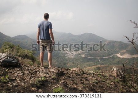 Beautiful landscape with a man overlooking the valley in the mountains in Amedzofe in the Volta Region, Ghana - stock photo