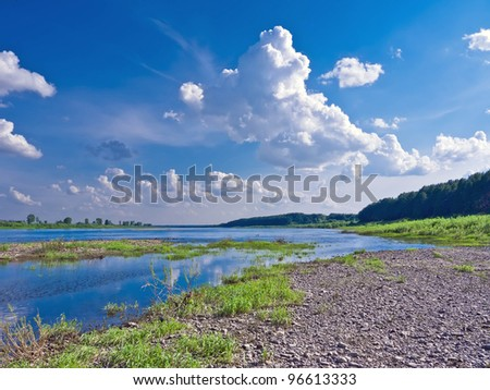 Beautiful landscape with a river on a sunny day - stock photo